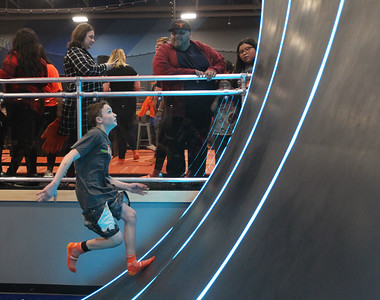 Candace H. Johnson-For Shaw Media Logan Hansen, 13, of Vernon Hills runs up the Warped Wall during the grand opening celebration of the Sky Zone indoor trampoline park in Vernon Hills.(4/24/18)