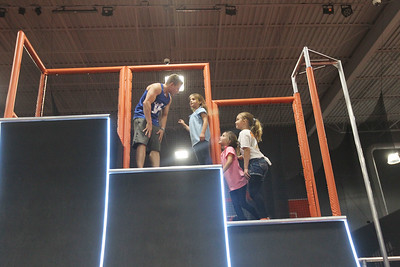 Candace H. Johnson-For Shaw Media  Jonathan Horton, of Houston, Texas, a two-time Olympian medalist and American Ninja Warrior, talks with Claire Mills, 7, of Long Grove and her sisters, Elle, 7, and Jenna, 9, after they landed on the top of the Warped Wall during the grand opening celebration of the Sky Zone indoor trampoline park in Vernon Hills.(4/24/18)