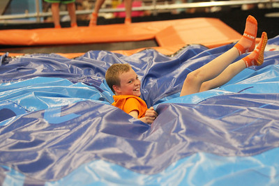 Candace H. Johnson-For Shaw Media James Elliott, 10, of Lake Bluff lands after jumping on a trampoline in the Drop Zone during the grand opening celebration of the Sky Zone indoor trampoline park in Vernon Hills.(4/24/18)