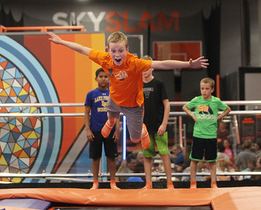 Candace H. Johnson-For Shaw Media James Elliott, 10, of Lake Bluff jumps on a trampoline in the Drop Zone during the grand opening celebration of the Sky Zone indoor trampoline park in Vernon Hills.(4/24/18)