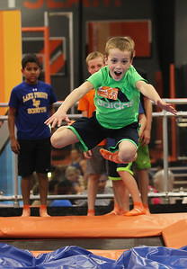 Candace H. Johnson-For Shaw Media William Elliiott, 8, of Lake Bluff leaps high in the air before landing during the grand opening celebration of the Sky Zone indoor trampoline park in Vernon Hills.(4/24/18)