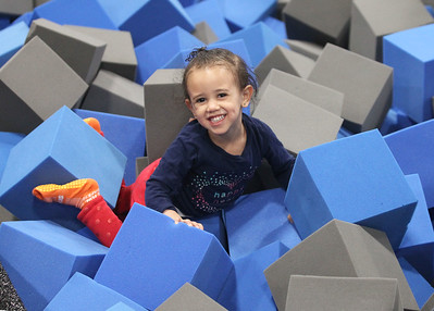 Candace H. Johnson-For Shaw Media Autumn Duboff, 2, of Great Lakes is all smiles as she plays in the foam cubes in the Challenge Zone during the grand opening celebration of the Sky Zone indoor trampoline park in Vernon Hills.(4/24/18)