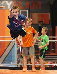 Candace H. Johnson-For Shaw Media Ethan Farrell, 9, of Lake Forest jumps on a trampoline as he makes a soft landing in the Drop Zone during the grand opening celebration of the Sky Zone indoor trampoline park in Vernon Hills.(4/24/18)