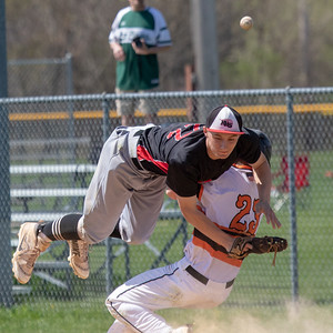 McHenry's Huntley's Nick Morris collides with Huntley first baseman Hunter Rumachik Saturday, May 5, 2018 in McHenry. Neither were injured on the play. McHenry went on to win the close game 2-1. KKoontz- For Shaw Media