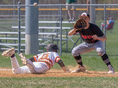 McHenry's Joe Kaminski dives back into first against Huntley Saturday, May 5, 2018 in McHenry. McHenry went on to win the close game 2-1. KKoontz- For Shaw Media
