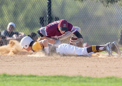 Jacobs' Braeden Wegner dives back into first under the tag by Prairie Ridge first baseman Nick Sargeant Monday, May 7, 2018 in Algonquin. Prairie Ridge takes the win 12-6. KKoontz- For Shaw Media