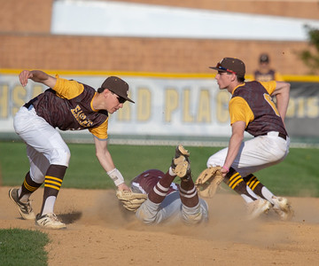 Prairie Ridge's Nick Sargeant is tagged out at second by Jacobs' shortstop Bryan Belo (L) Monday, May 7, 2018 in Algonquin. Prairie Ridge takes the win 12-6. KKoontz- For Shaw Media
