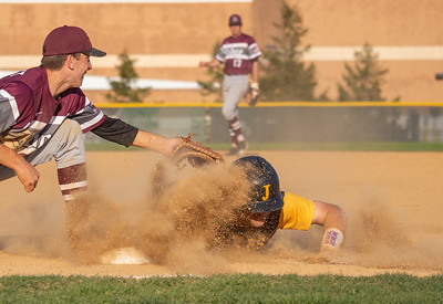 Jacobs' Daniel Klein dives back into first under the tag by Prairie Ridge first baseman Nick Sargeant Monday, May 7, 2018 in Algonquin. Prairie Ridge takes the win 12-6. KKoontz- For Shaw Media