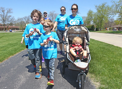 Candace H. Johnson-For Shaw Media The Meade family, of Grayslake and the Martin family, of Third Lake walk together on the trail during the free Go Grayslake Community Walk in Central Park in Grayslake.The event was sponsored by the Grayslake Community Park District.(5/6/18)