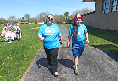 Candace H. Johnson-For Shaw Media Amy Thomas, of Grayslake and her son, Gabriel, 12, walk on the trail behind the Grayslake Middle School during the free Go Grayslake Community Walk in Central Park in Grayslake.The event was sponsored by the Grayslake Community Park District. (5/6/18)