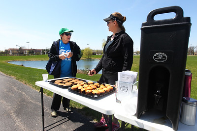 Candace H. Johnson-For Shaw Media Polly Machak, of Grayslake talks with Linda Scholz, owner of Something's Brewing, as she gives out cookies, muffins and coffee during the free Go Grayslake Community Walk in Central Park in Grayslake.The event was sponsored by the Grayslake Community Park District. Over twenty-nine different organizations set up tables along the trail for the walkers. (5/6/18)