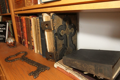 Candace H. Johnson-For Shaw Media Personal items such as a key to Alaska sits close to a family Bible dated from around the 1800's was on display in the study at the Adlai E. Stevenson II Historic Home located in the Captain Daniel Wright Woods Forest Preserve in Mettawa. (5/3/18)