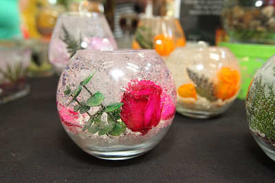 Candace H. Johnson-For Shaw Media Clear Candle, refillable illuminating candle art made with real flowers, was sold by Diane Sineni, of Wheeling  during the Spring Craft Fair at Gurnee Mills.(5/6/18)