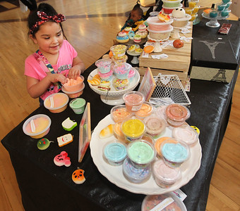 Candace H. Johnson-For Shaw Media Mirella Ceja, 6, of Waukegan plays with Tropical Cloud Slime at the Squish Slime & Dough Co. booth during the Spring Craft Fair at Gurnee Mills.(5/6/18)