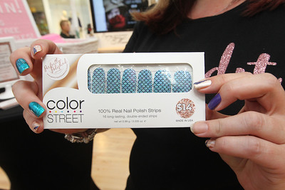 Candace H. Johnson-For Shaw Media Kristen Mihevc, of Volo, in independent sales for Color Street, holds up a package of real nail polish strips that last between seven and fourteen days she was selling during the Spring Craft Fair at Gurnee Mills.(5/6/18)