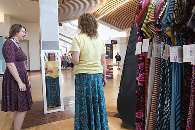 Candace H. Johnson-For Shaw Media Samantha Sammartino, of Antioch, a LuLaRoe fashion consultant, helps Tammy Robards, of Gurnee with picking out a maxi skirt during the Spring Craft Fair at Gurnee Mills.(5/6/18)
