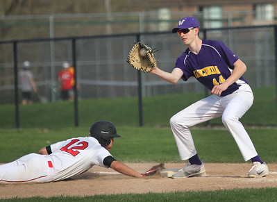 Candace H. Johnson-For Shaw Media Grant's Steven Jackson dives safely back to first before the tag by Wauconda's Clark Morgan in the third inning at Grant Community High School in Fox Lake. Wauconda won 9-3.(5/8/18)