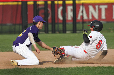 Candace H. Johnson-For Shaw Media Wauconda's Brett Winkel tags out Grant's Valentin Cerna before he gets to second base in the second inning at Grant Community High School in Fox Lake. Wauconda won 9-3.