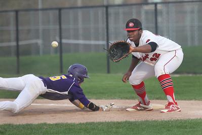 Candace H. Johnson-For Shaw Media Wauconda's Keegan Henley dives back to first as Grant's Mikal Ashley takes the throw in the sixth inning at Grant Community High School in Fox Lake. Wauconda won 9-3.