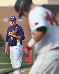 Candace H. Johnson-For Shaw Media Wauconda pitcher Jake Harmon watches Grant's Chase Maifield come up to bat in the fourth inning at Grant Community High School in Fox Lake. Wauconda won 9-3.