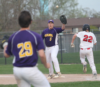 Candace H. Johnson-For Shaw Media Wauconda's Jake Harmon makes the catch for an out on first against Grant's Joe Gorden in the seventh inning at Grant Community High School in Fox Lake. Wauconda won 9-3.(5/8/18)