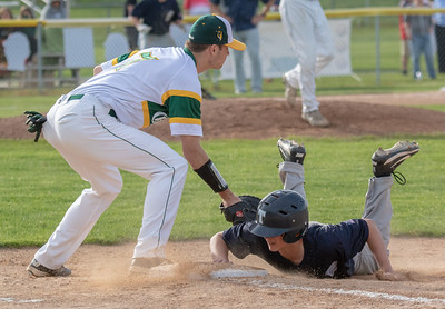 Cary Grove's Joseph Tyche dives back into first base ahead of the tag by Crystal Lake South first baseman Blake Kuffel Thursday, May 17, 2018 in Crystal Lake. Cary went on to win 12-5. KKoontz – For Shaw Media