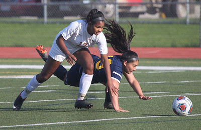 Candace H. Johnson-For Shaw Media Carmel's Zenaya Barnes and Round Lake's Stephanie Calderon chase a loose ball in the second half during the Class 3A regional semifinal game at Mundelein High School. Carmel won 5-0.(5/15/18)