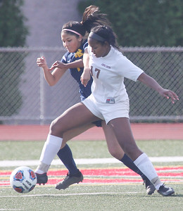 Candace H. Johnson-For Shaw Media Round Lake's Citlalli Suarez battles for control with Carmel's Zenaya Barnes in the first half during the Class 3A regional semifinal game at Mundelein High School. Carmel won 5-0.(5/15/18)