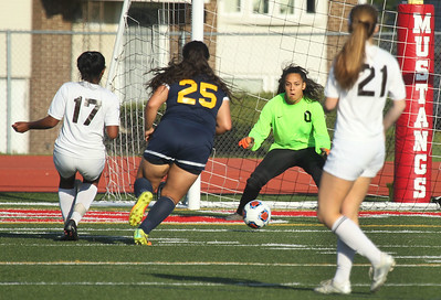 Candace H. Johnson-For Shaw Media Carmel's Zenaya Barnes (#17) takes a shot on goal against Round Lake's Giselle Raygoza (#0) in the second half during the Class 3A regional semifinal game at Mundelein High School. Carmel won 5-0.(5/15/18)