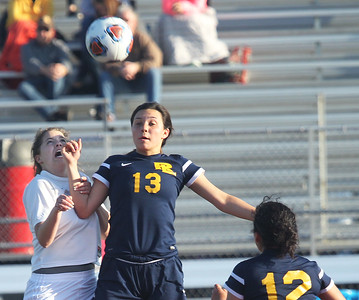 Candace H. Johnson-For Shaw Media Carmel's Kylee Smith and Round Lake's Dana Devera go up for a header in the second half during the Class 3A regional semifinal game at Mundelein High School. Carmel won 5-0.(5/15/18)