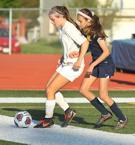 Candace H. Johnson-For Shaw Media Carmel's Emma Heinrich battles for control with Round Lake's Natasha Wawrzyniak in the second half during the Class 3A regional semifinal game at Mundelein High School. Carmel won 5-0.(5/15/18)