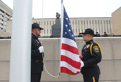 Candace H. Johnson-For Shaw Media Detective Joe Jurek and Sgt. Frank Lopez, both with the Waukegan Police Honor Guard, wait to raise the American flag during the Police Memorial at Lincoln Memorial Plaza in Waukegan. (5/11/18)