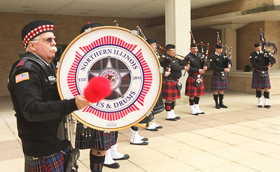 Candace H. Johnson-For Shaw Media John Gilleran, of Lake Zurich beats his drum with the Northern Illinois Pipes & Drums during the Police Memorial at Lincoln Memorial Plaza in Waukegan. (5/11/18)