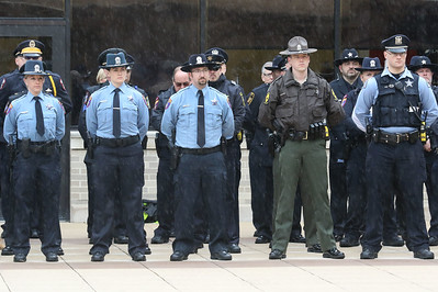 Candace H. Johnson-For Shaw Media Lake County police officers stand together during the Police Memorial at Lincoln Memorial Plaza in Waukegan. (5/11/18)