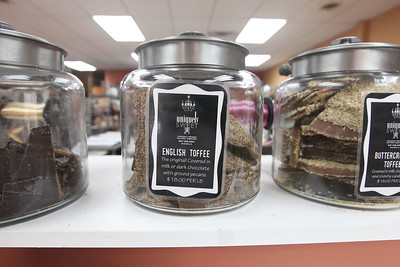 Candace H. Johnson-For Shaw Media English toffee sits in a glass jar for customers to buy at Uniquely Sweet on Belvidere Road in Grayslake.The store offers six different varieties of toffee made on site which include, Chicago, Cheesecake, Taffy Apple, Oreo, Dark Chocolate Sea Salt, and English toffee, their #1 seller.(5/15/18)