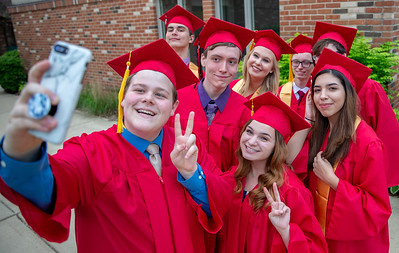 Faith Lutheran High School class of 2018 graduates pose for the camera Friday, May 18, 2018 in Crystal Lake.  KKoontz for Shaw Media