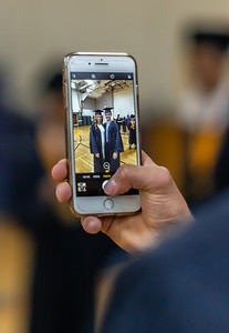 Students from Cary-Grove High School take photos of friends before the graduation ceremony Saturday, May 19, 2018 in Cary.  KKoontz- For Shaw Media