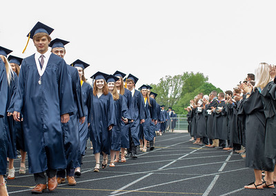 Students from Cary-Grove High School make their way past their teachers and onto the football field before the graduation ceremony Saturday, May 19, 2018 in Cary.  KKoontz- For Shaw Media
