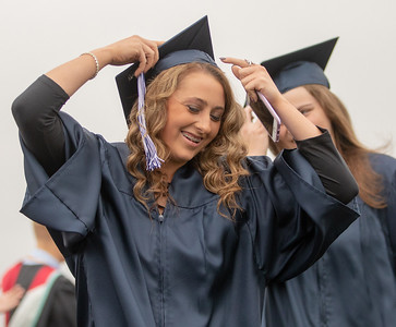 A Cary-Grove High School student makes a last minute mortar board adjustment before the graduation ceremony Saturday, May 19, 2018 in Cary.  KKoontz- For Shaw Media
