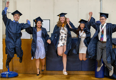 Students from Cary-Grove High School jump for joy before the graduation ceremony Saturday, May 19, 2018 in Cary.  KKoontz- For Shaw Media