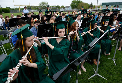 (L-R) Crystal Lake South graduates Audrey Godspell and Olivia Perovic play the flute as they perform for the last time with the band during their graduation on Saturday, May 19, 2018 in Crystal Lake, Illinois. John Konstantaras photo for Shaw Media