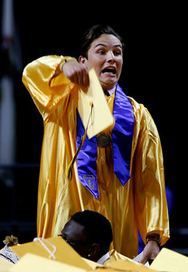 courtesy of the Daily Herald, Daniel WhiteLuke Benner throws his cap to celebrate the Jacobs High School graduation at the Sears Centre in Hoffman Estates.