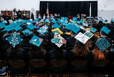Graduates express themselves on their mortar boards during the Woodstock North High School graduation on Saturday, May 19, 2018 in Woodstock, Illinois. John Konstantaras photo for Shaw Media