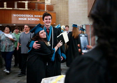 Haley Citero-Bunker and Joseph Binder get their photo taken after the Woodstock North High School graduation on Saturday, May 19, 2018 in Woodstock, Illinois. John Konstantaras photo for Shaw Media