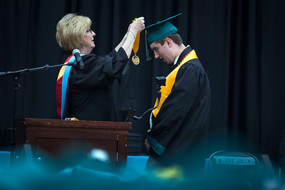Principal Darlea Livengood puts a medal on Salutatorian  Justin Wesolek during the Woodstock North High School graduation on Saturday, May 19, 2018 in Woodstock, Illinois. John Konstantaras photo for Shaw Media