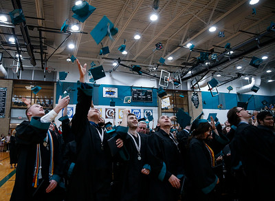 Woodstock North High School graduates toss their caps in the air to conclude their ceremony on Saturday, May 19, 2018 in Woodstock, Illinois. John Konstantaras photo for Shaw Media