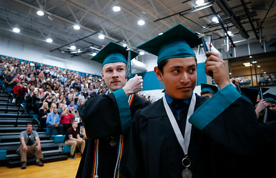 Mitchell Ahrens and Riley Alcaraz flip their tassels after receiving their diplomas at the Woodstock North High School graduation on Saturday, May 19, 2018 in Woodstock, Illinois. John Konstantaras photo for Shaw Media