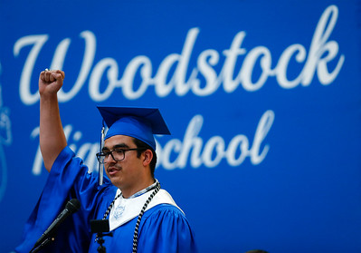 "Rafael Cabrera raises his fist as he shouts ""Go Streaks"" at the end of his Senior Reflection during the Woodstock High School graduation on Sunday, May 20, 2018 in Woodstock, Illinois. John Konstantaras photo for Shaw Media"