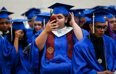 Paige Olandese adjusts her cap as she waits with her classmates for the start of the Woodstock High School graduation on Sunday, May 20, 2018 in Woodstock, Illinois. John Konstantaras photo for Shaw Media