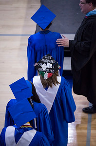 "Vanessa Tapia walks toward the stage to accept her diploma with the message ""They Migrated So I Graduated"" on her mortar board at the Woodstock High School graduation on Sunday, May 20, 2018 in Woodstock, Illinois. John Konstantaras photo for Shaw Media"
